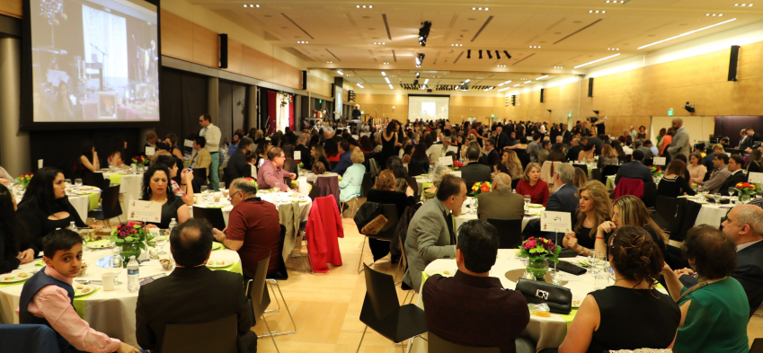 Guests at Nowruz sitting at their tables during the event