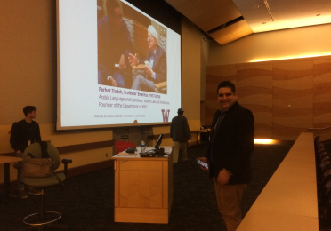 Professor Lior Sternfield standing near the podium before his presentation