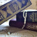 Photo of a copy of the Quran in Arabic, one in English, and the Jewish Tanakh in both Hebrew and English